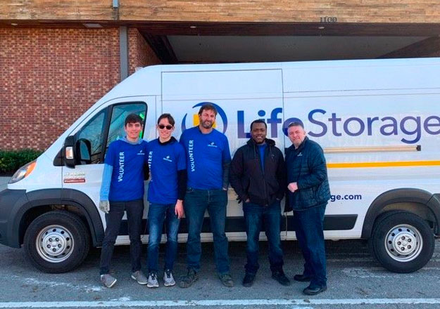 Life Storage team members posing in front of company moving van