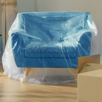 Blue chair wrapped in plastic protcetive cover