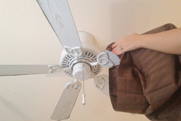 Clean a Ceiling Fan with an Old Pillowcase