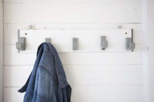 clothes rack with a jeans jacket in a beach cabin