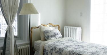 bed bedroom white bedspread blue pattern