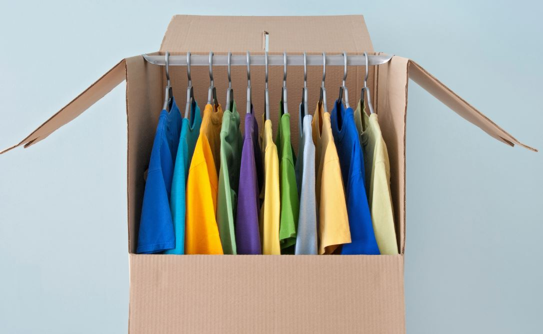 Place clothes in a box in a way that doesn't require many folds or sharp creases