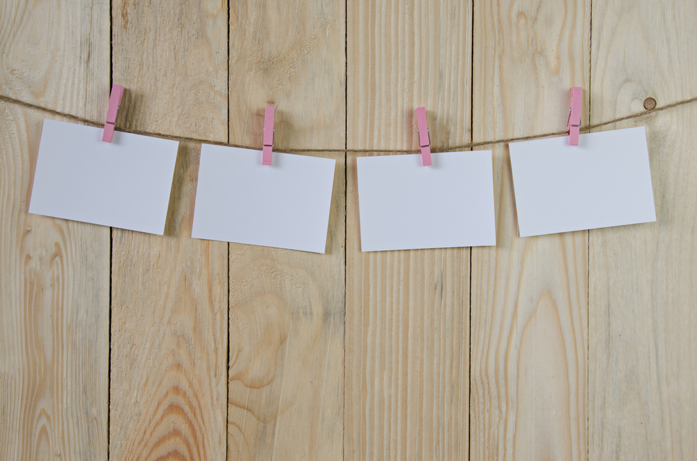last-minute bridal shower decoration ideas: clothespin photos