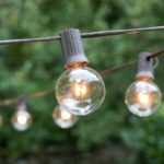 Simple outdoor string lights make even the dreariest outdoor space dreamy!
