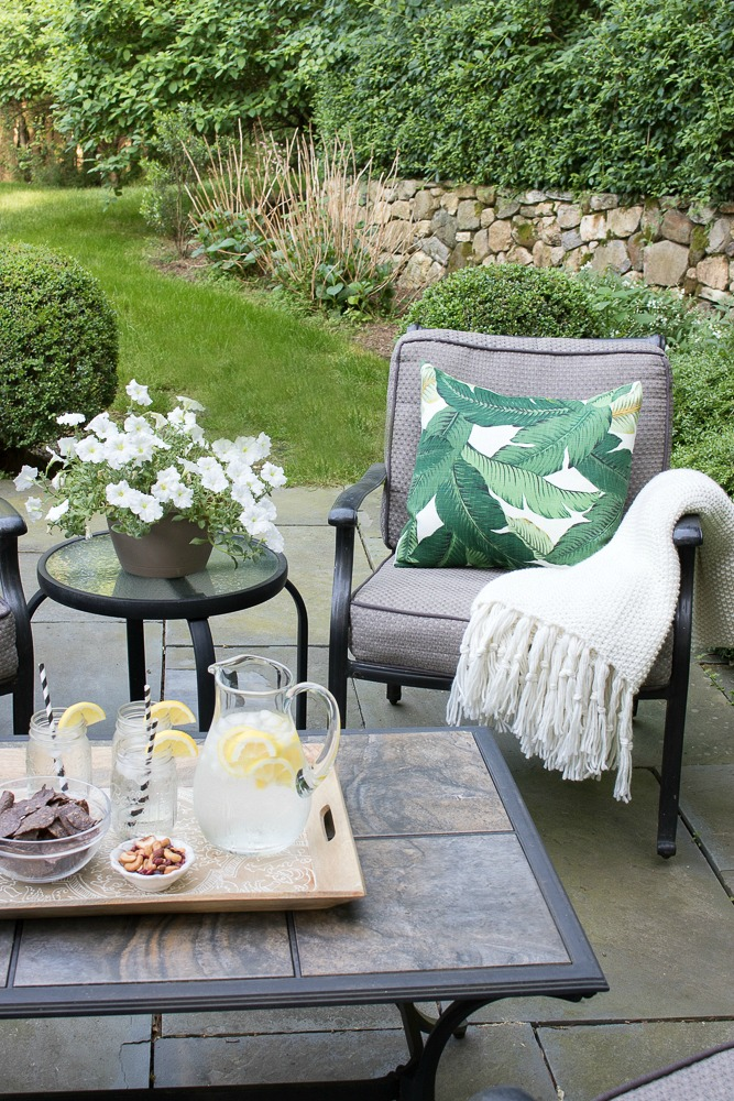 Throws and pillows are perfect for softening up your outdoor living space and adding some stylish color and pattern.jpg