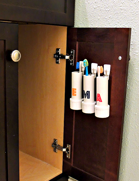 hidden storage ideas: Hidden Toothbrush Holder