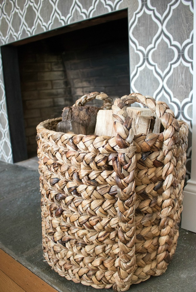 Use a Basket to Store Logs by a Fireplace