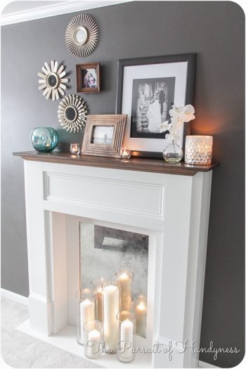 faux fireplace bare grey wall decor candles