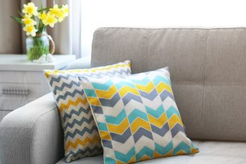 neutral furniture colorful couch pillow flowers