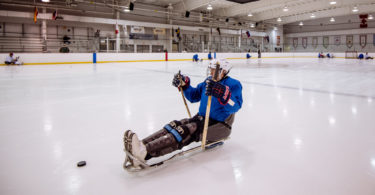 sled hockey player blue jersey