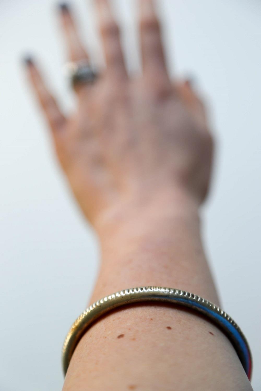 metal bangle bracelet on arm