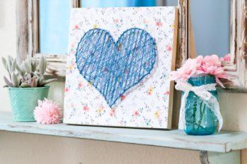 blue string heart mantel decor board