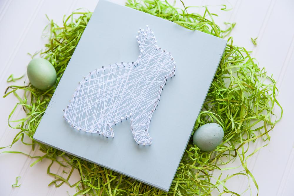 white string bunny sign easter eggs grass