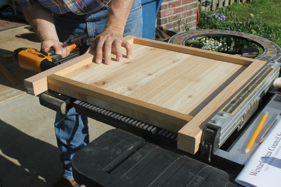 2x4 cedar wood nail gun on table saw
