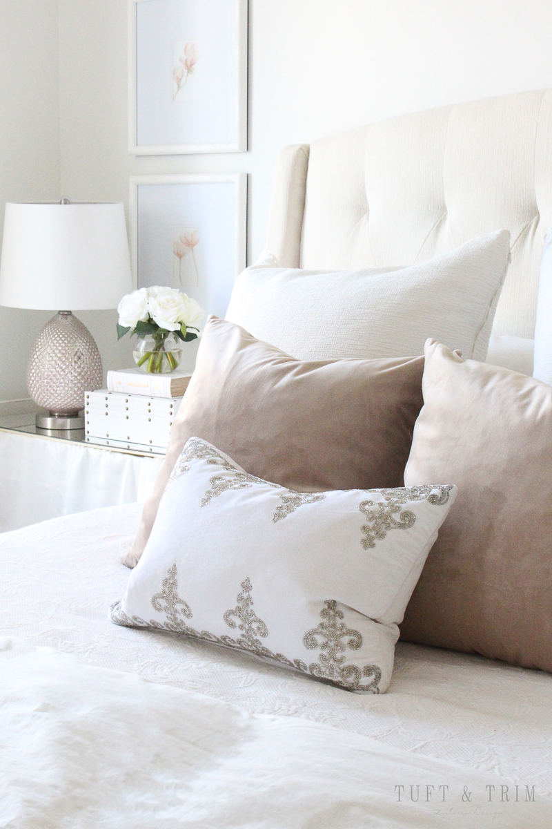how to decorate a master bedroom - pile on the pillows