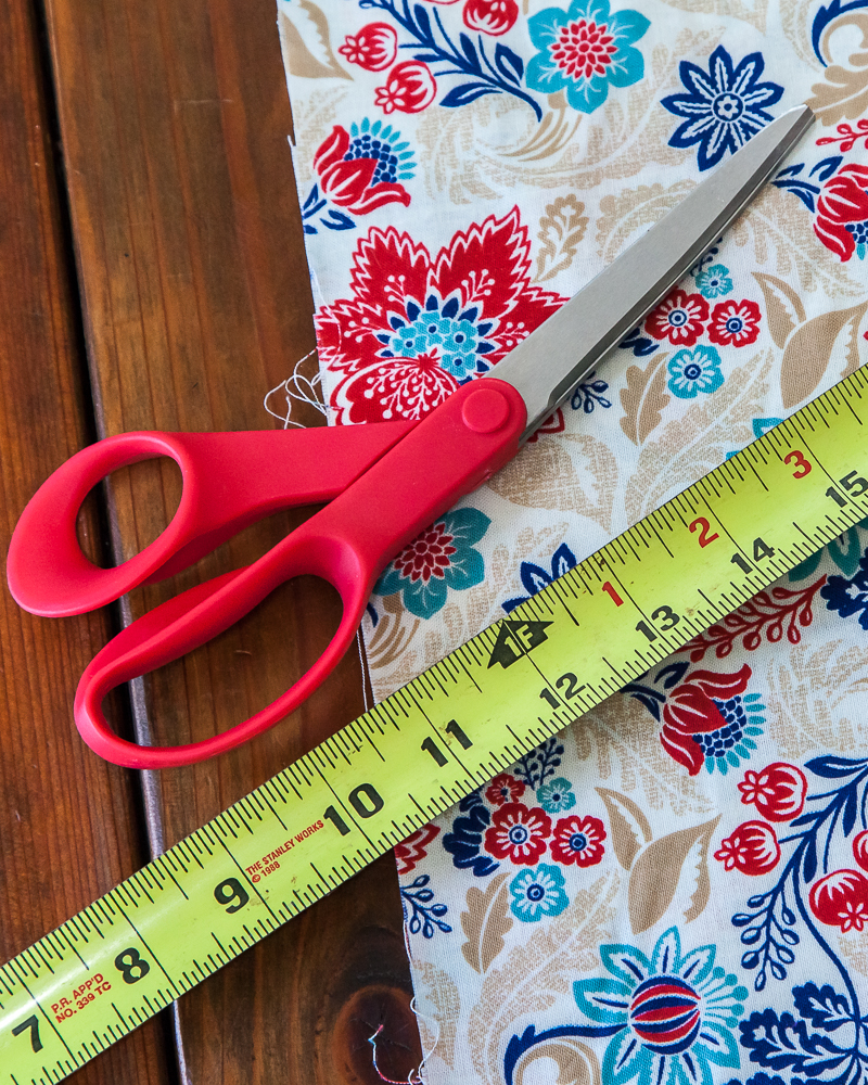 measuring tape red scissors fabric measure and cut fabric