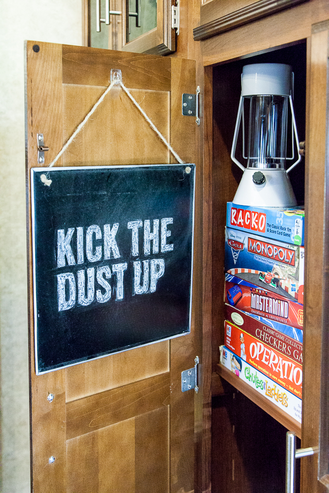 kick the dust up rv decor board games stored in closet