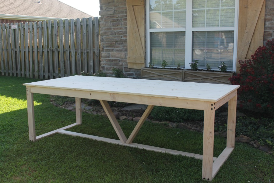 unstained diy farmhouse table on lawn