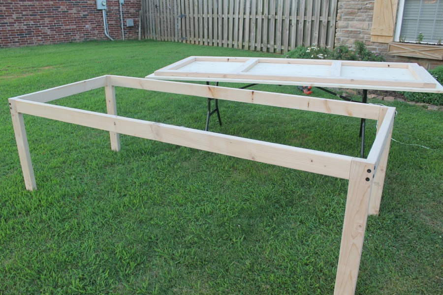 table top and base disconnected on grass - DIY Farmhouse Table Build