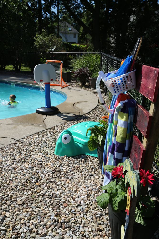 poolside storage rack pool toys organized
