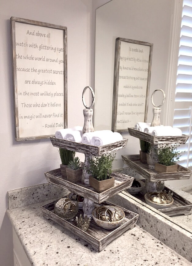 Bathroom Organization Ideas: a tiered tray to organize bath towels and toiletries right on the vanity