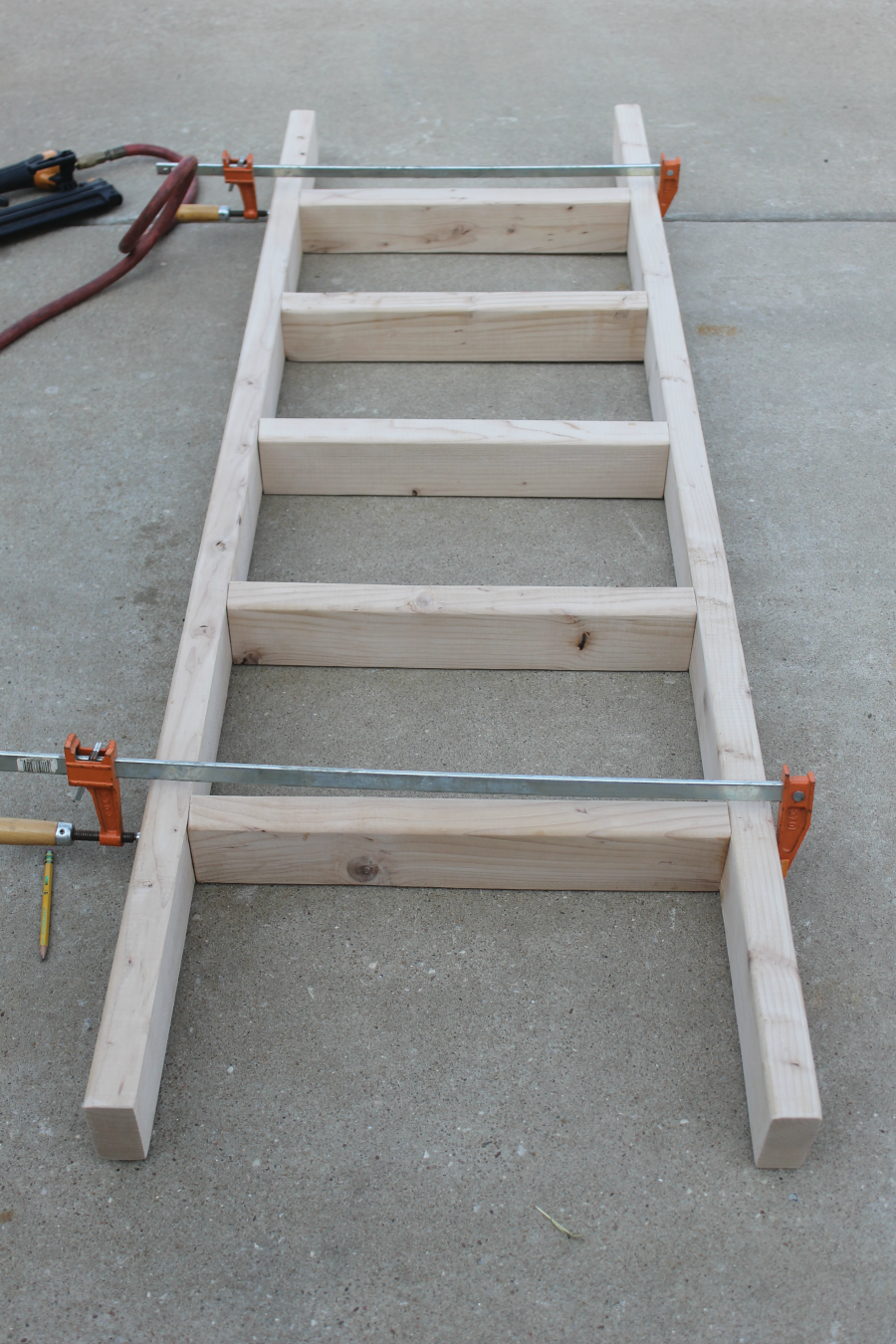 How to make a diy blanket ladder for just 10 life storage blog how to make a ladder clamp and allow wood glue to dry solutioingenieria Gallery
