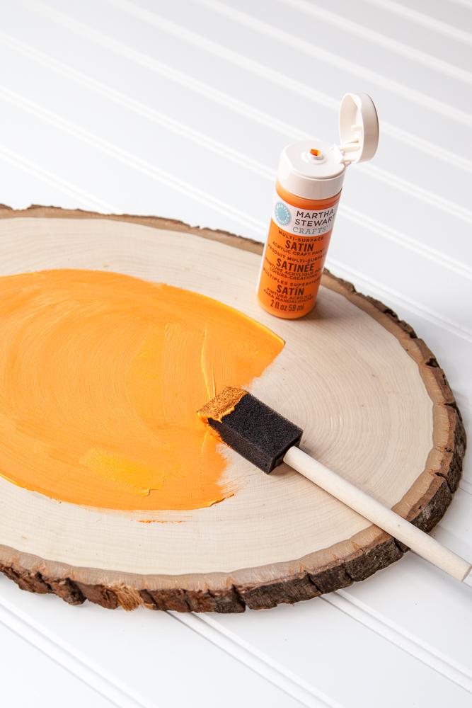 Outdoor Fall Decorating Ideas - orange paint on wood slice diy