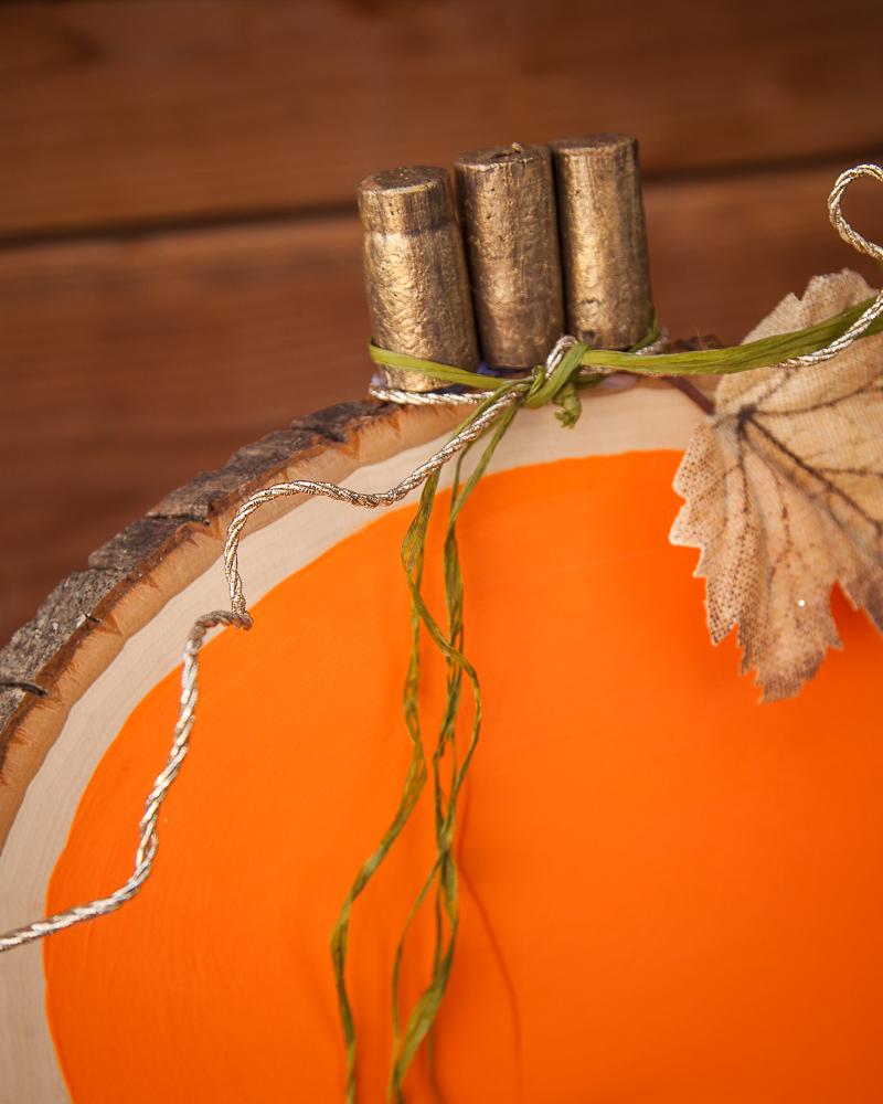 Outdoor Fall Decorating Ideas - wine cork wood slice pumpkin diy