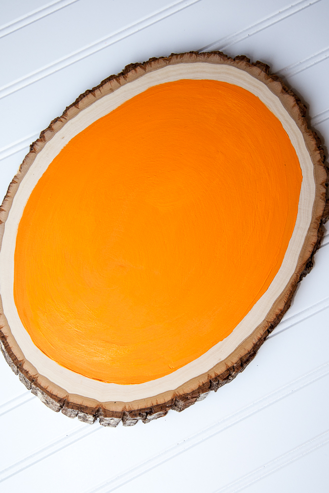 Outdoor Fall Decorating Ideas - orange paint on wood slice diy dry
