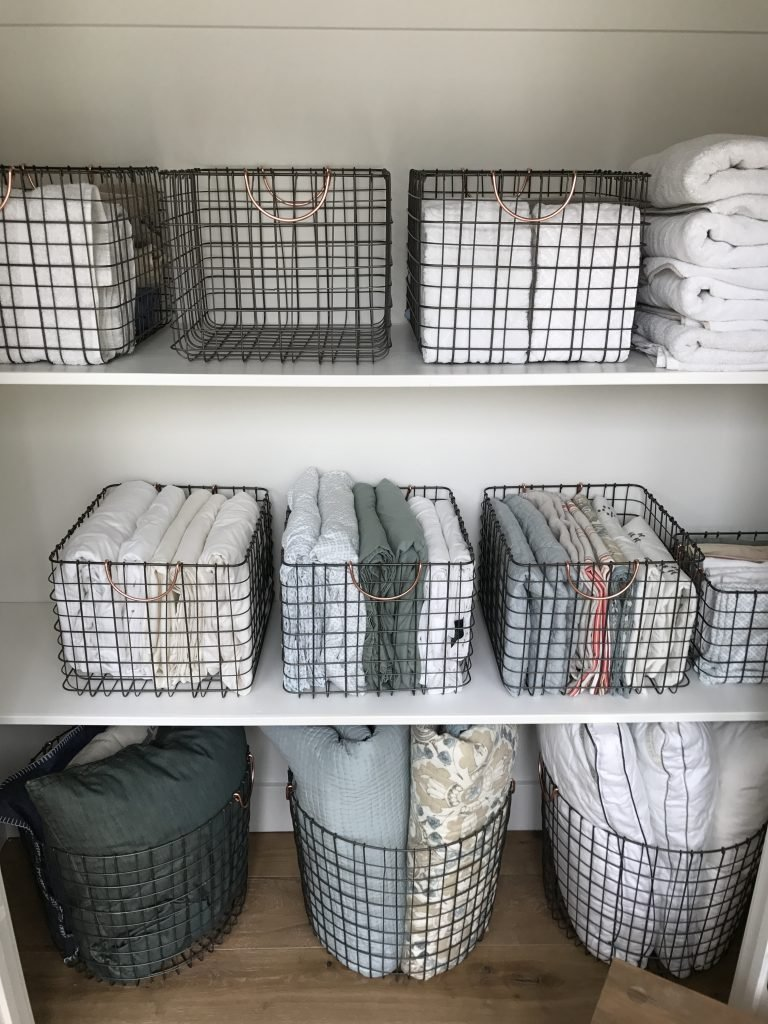 hall closet organization and storage ideas - linen closet wire baskets