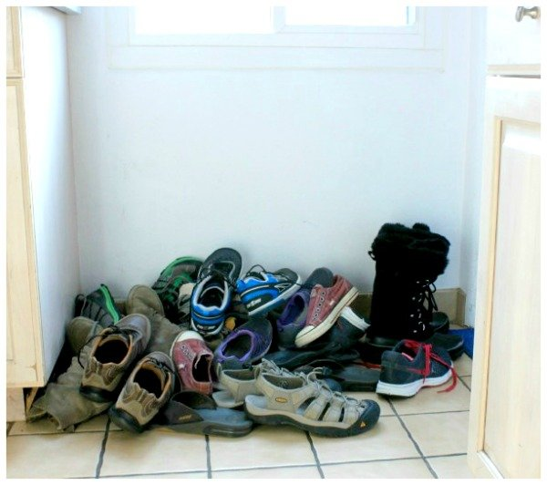hall closet organization ideas and hall closet storage ideas - pile of unorganized shoes before