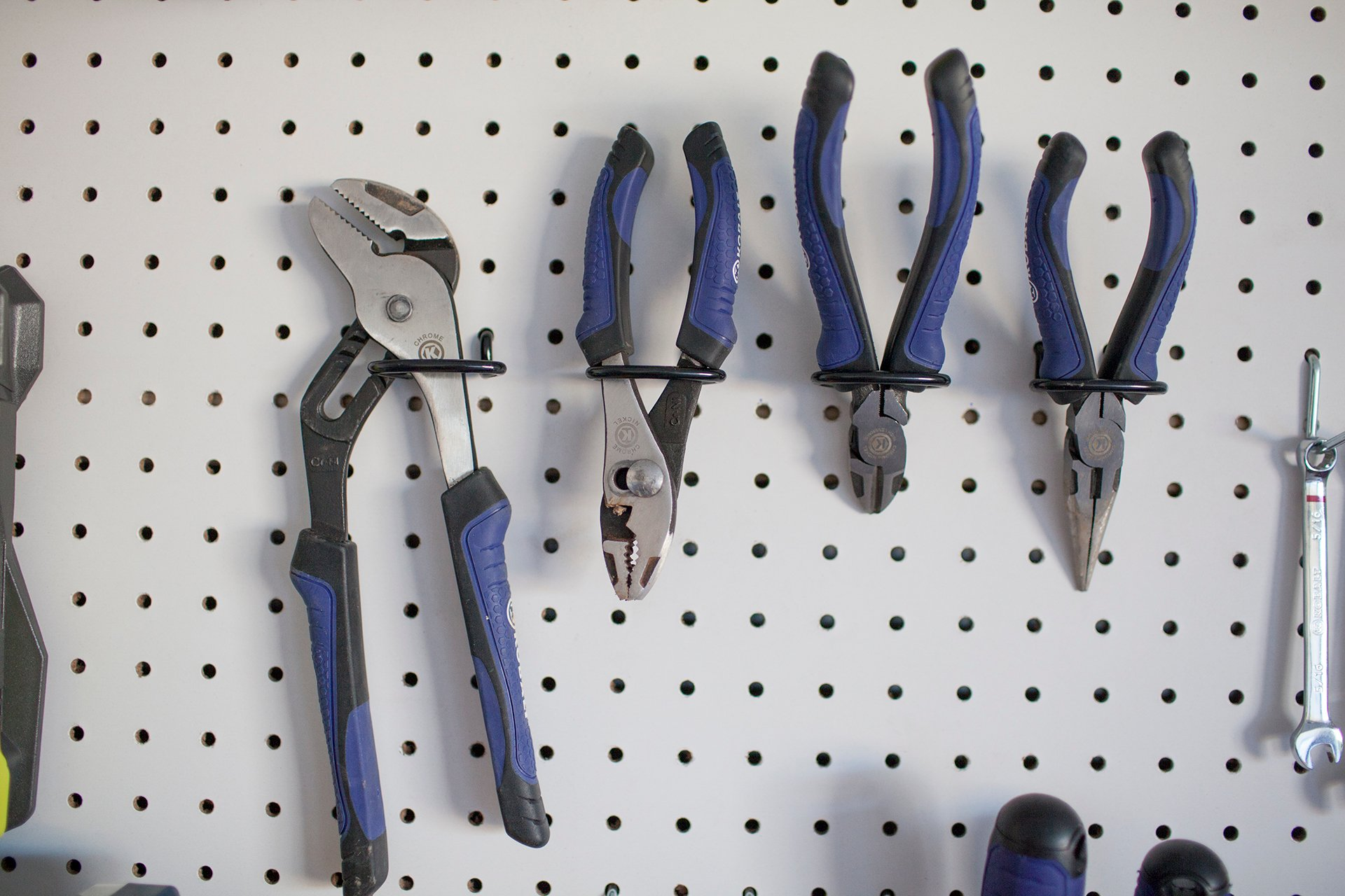 hang pegboard accessories and tools to organize garage