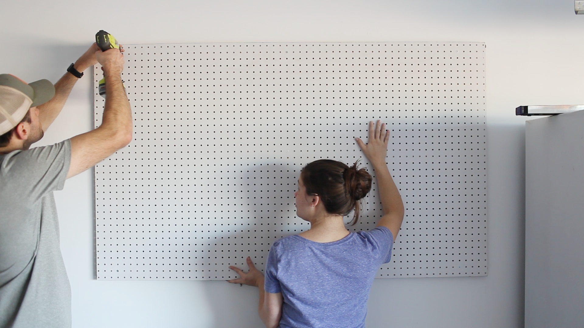 mount pegboard to garage wall and secure