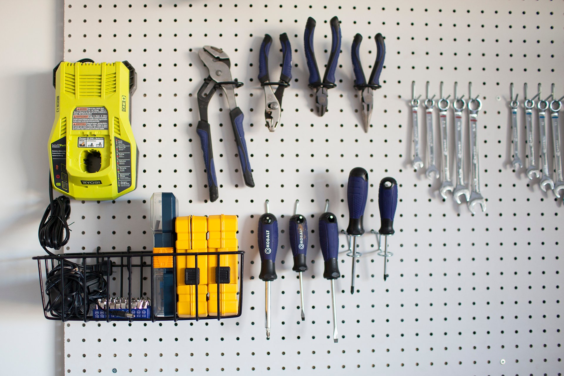 How to organize tools with a garage pegboard life storage blog for an in depth visual of how to make and install your own diy garage pegboard watch this tutorial video solutioingenieria Images