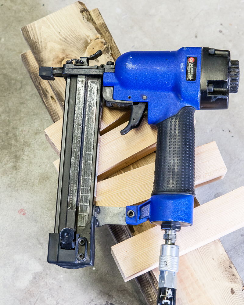 blue power drill over plywood