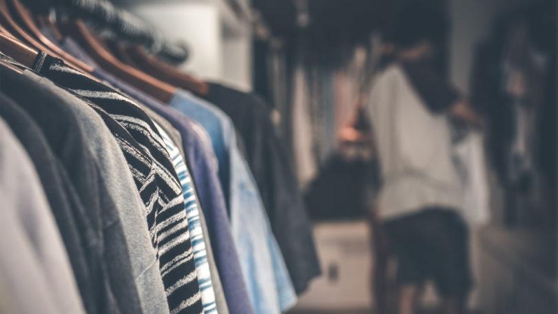 DIY closet organization ideas on a budget: woman organizing closet