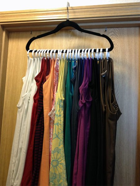 DIY closet organization ideas on a budget: use shower curtain hooks to hang items like tank tops, jeans and jewelry.