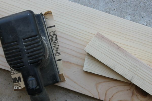 Sand your wood using a hand sander and sandpaper, as part of our DIY under-the-sink shelving project from our favorite small bathroom storage ideas.