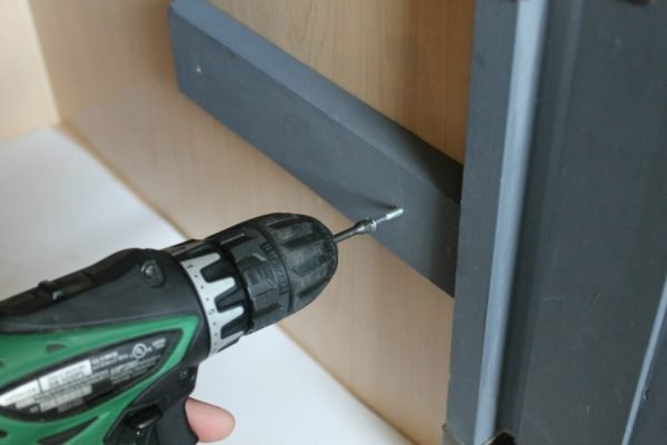 Screw the piece in place using your drill and the wood screws.