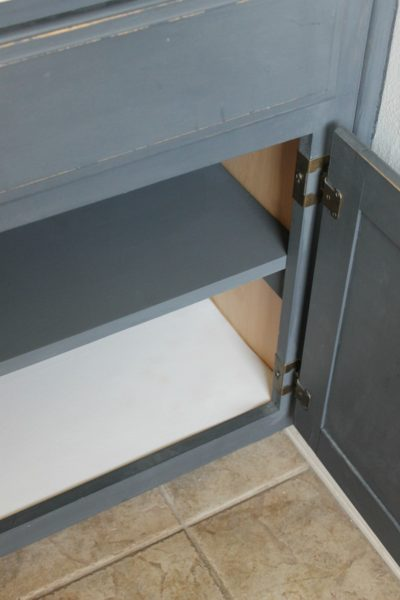 A preview of our final, empty DIY under-the sink shelves, as part of our favorite small bathroom storage ideas.