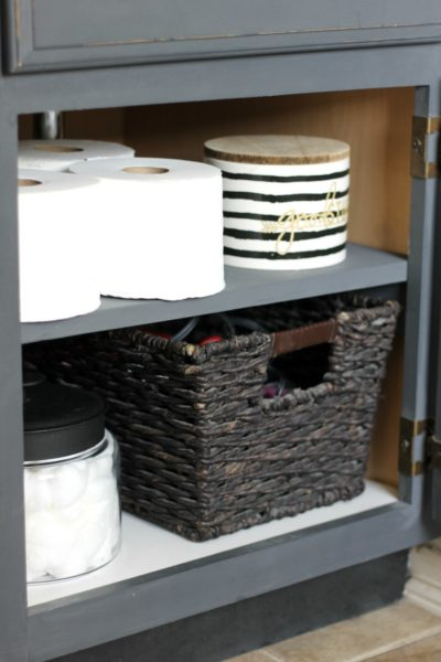 These under-the-sink shelves are a great DIY addition to our list of small bathroom storage ideas.