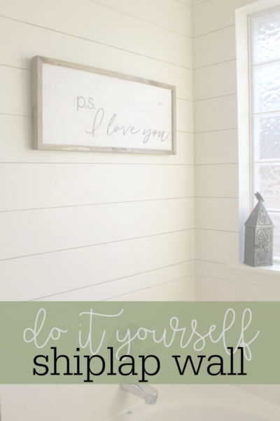 Transform your small bathroom for only $50 with our DIY shiplap accent wall tutorial.