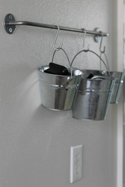 Use S hooks to hold buckets filled with jewelry, hair accessories, phone chargers and more.