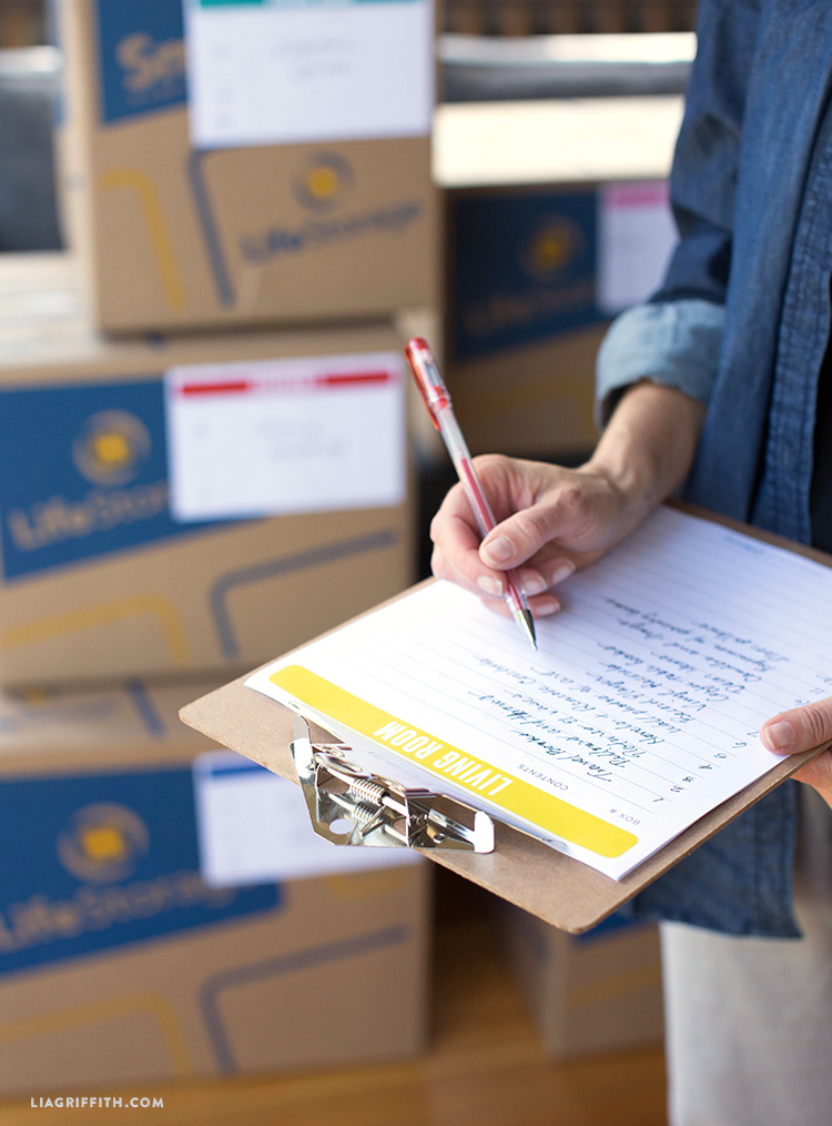 Moving Checklist - Moving Box Inventory on Clipboard to Stay Organized