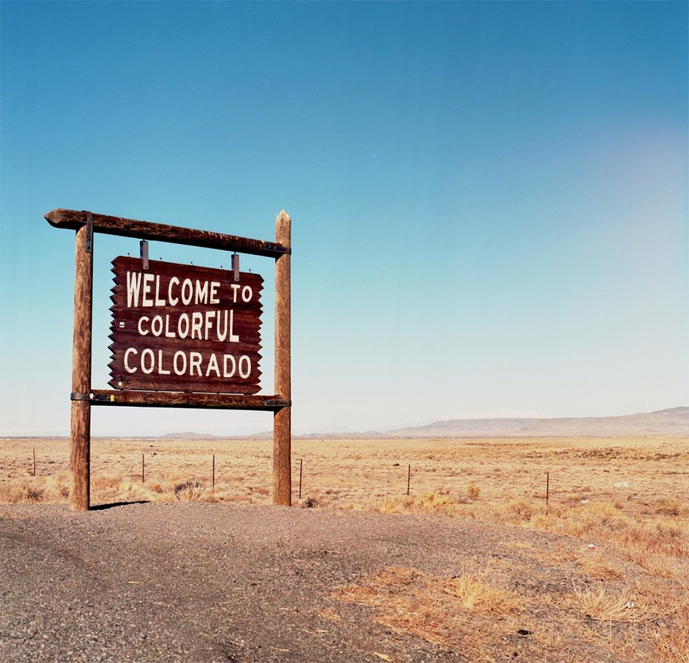 Best cities to live in Colorado: Welcome to Colorful Colorado sign on the highway