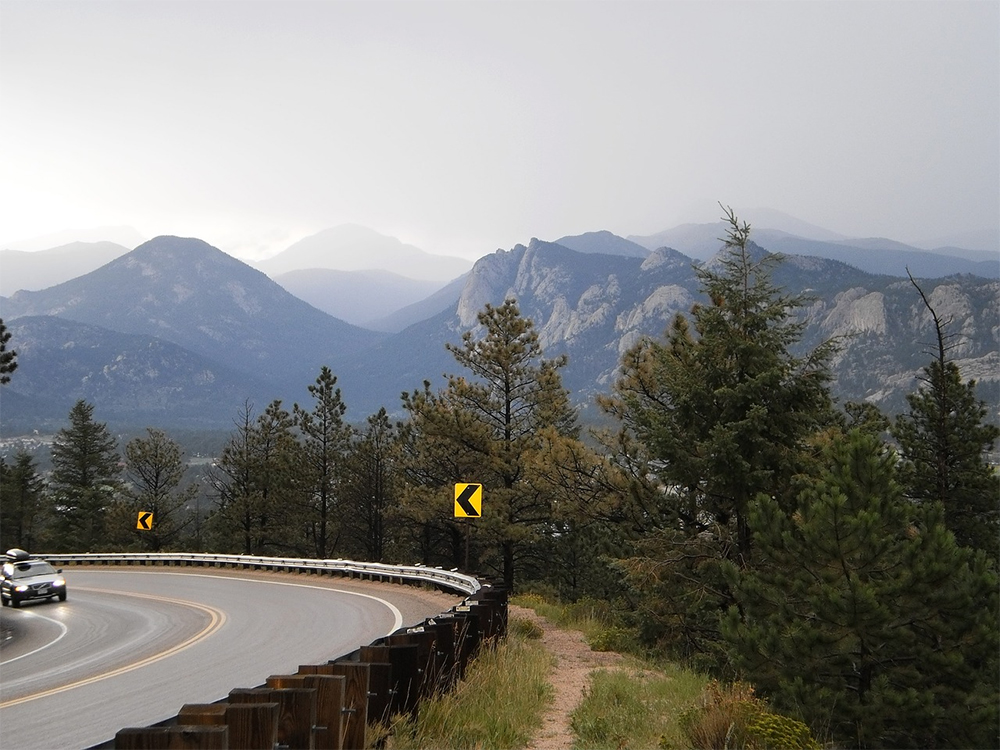Best cities to live in Colorado: mountains in the background of the highway