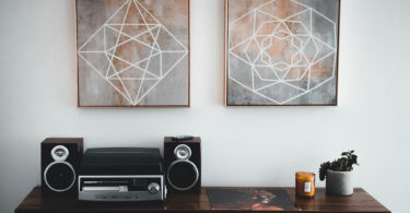 Room decoration ideas for couples: two posters over speaker