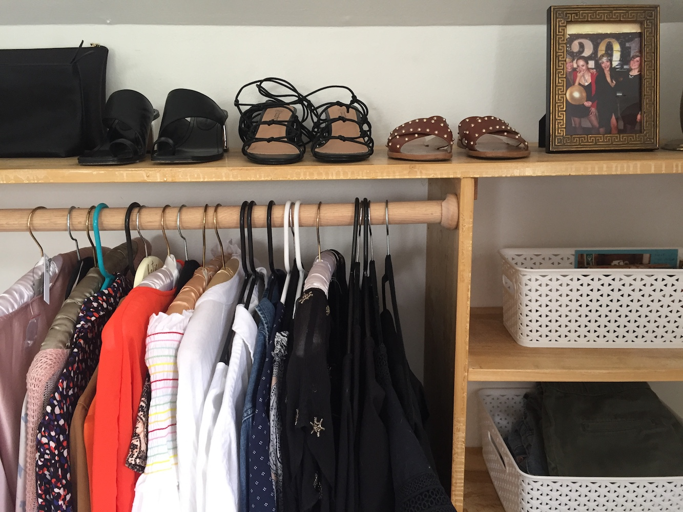 DIY Dressing Room: closet with clothes, shoes, and bins