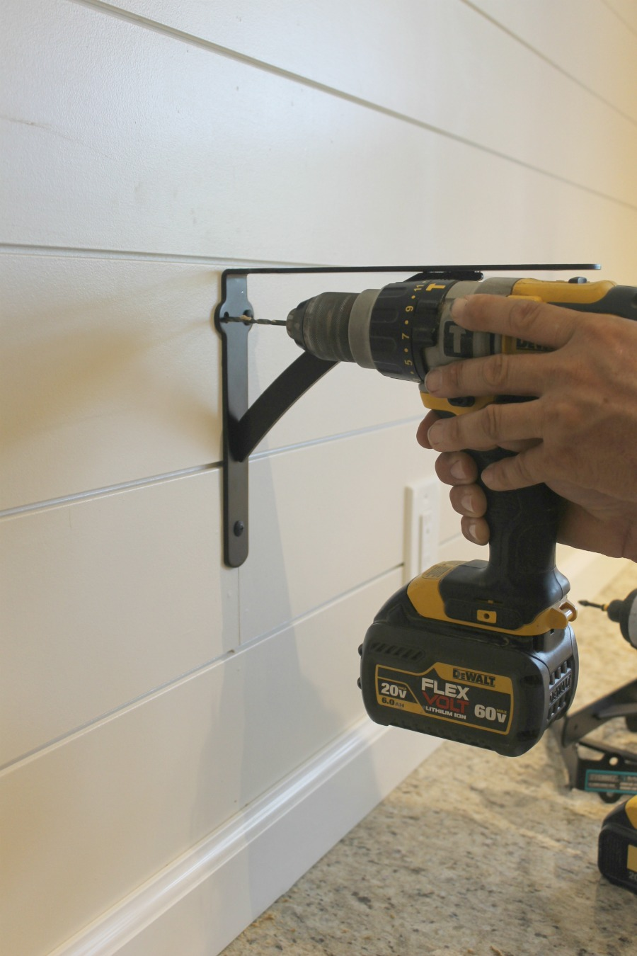 How to build DIY kitchen shelves - drill the brackets into the wall