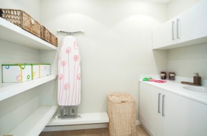 Maximize space in laundry room with shelves baskets wall hanging units